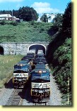 The Tunnels After: The passage of two westbound double-stack trains highlights why this tunnel was enlarged in 1994.  Originally, the Allegheny Tunnel had one track and allowed trains up to 19' in height.  It now has two tracks and clears a height of 21' 5